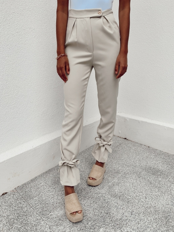 Beige PONY knotted pants