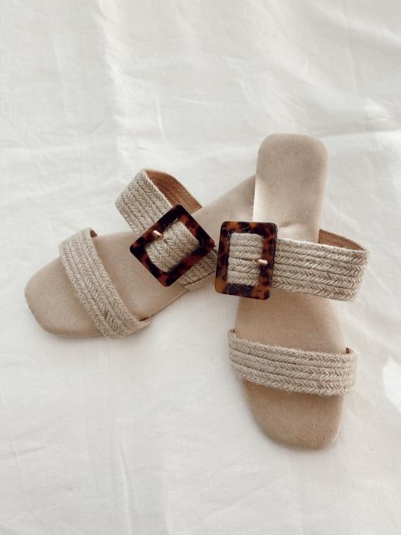 Beige CUNY tortoiseshell buckle flat sandals